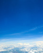 Beautiful view of blue sky above the white clouds from airplane window - 213581565