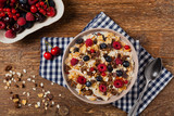 Breakfast, muesli with milk and fresh fruit. - 213582511