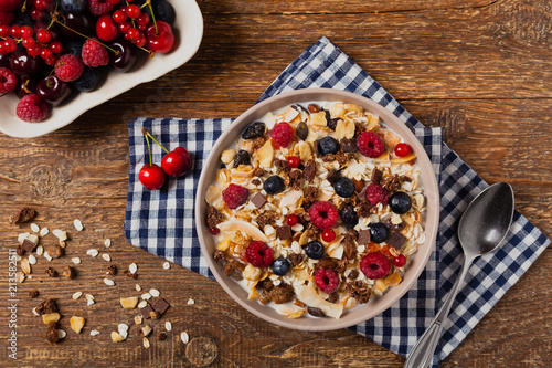 Leinwanddruck Bild Breakfast, muesli with milk and fresh fruit.