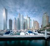 Day view of sea bay with yachts Dubai Marina, UAE