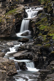 Beautiful cascade streaming in nature in Lyngenfjord, Norway.