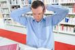 Man reading, arms behind head