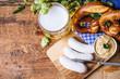 Leinwandbild Motiv Weißwurst, Brezn und ein Helles