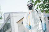 low angle view of pest control worker standing with sprayer - 213599399