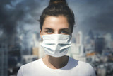 Woman wearing face mask because of air pollution in the city © blackday