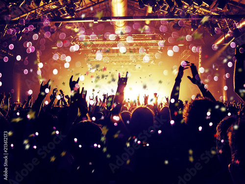 Rain of confetti on a concert crowd - 213612173