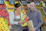 giving a free apple to a customer - 213613197