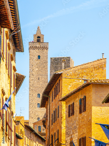 Torre Grossa, Big Tower. Bottom view from medieval streets of San Gimignano, Italy