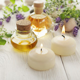 lavender essential oil, aromatherapy candles and flowers - 213617303