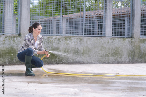 Fototapeta cleaning time for kennel assistant