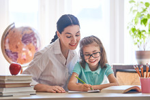 """Постер, картина, фотообои """"Mother and daughter are learning to write"""""""