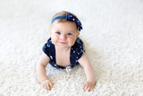 Cute adorable baby girl in blue clothes and headband. - 213636384