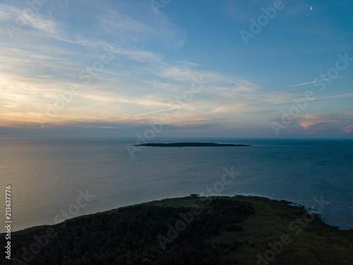 drone image. aerial view of sunrise over the islands in Baltic sea, Hiiumaa, Estonia - 213637776