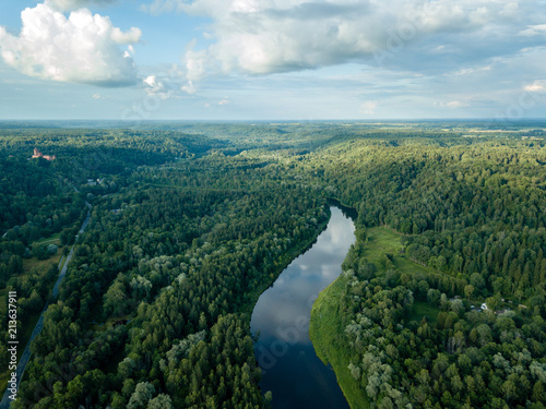 Fotobehang Zwart drone image. aerial view of forests and river Gauja in the middle in summer day. Latvia, Sigulda municipality