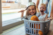 Kids rides in a laundry basket