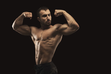 Strong athletic man showes naked muscular body © Prostock-studio