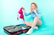 Leinwanddruck Bild - amazed girl holding red bra. young woman has found woman's bra in the husband's suitcase. take out unknown thing