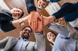 Team building, partnership, business success concept. Bottom view of business people putting hands together.