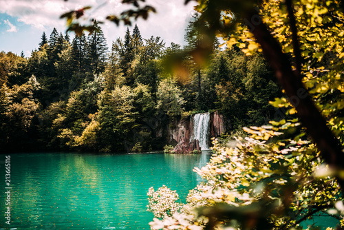 Majestic mountain waterfall and turquoise lake water. - 213665116