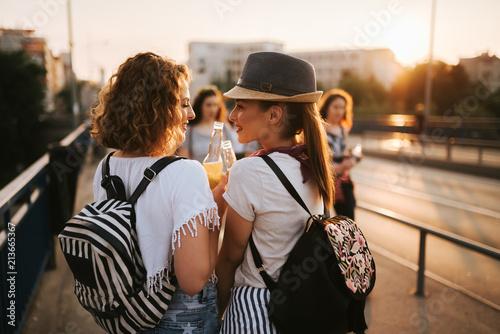 Fotobehang Muziek Two gorgeous girls having fun while walking to a music festival in the summer.