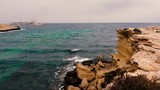 Beautiful seascape with rocky cliff, sea and cloudy sky on horizon - 213667794