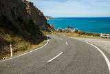 Road leading to a bay. Crystal clear water, amazing landscape. Windy road. Travel, adventure, discover, explore, drive, hike. Sea, ocean, environment, sky. - 213674708