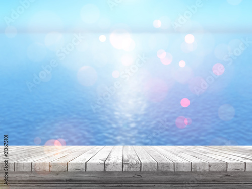 Foto Spatwand Lichtblauw 3D wooden table looking out to a blue ocean