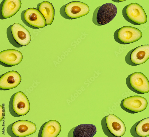 Fresh avocado pattern on a green background flat lay - 213690969