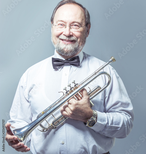 portrait of a musician with a pipe on a light background - 213693707