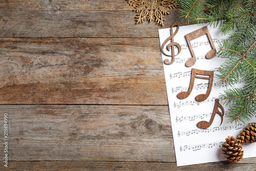 a72e9d1dddd95 £1.00 · Composition with music sheet and notes on wooden background.  Christmas songs concept
