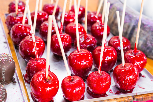 Foto Murales Red apples on a stick in caramel yum yum