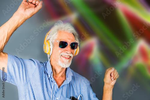 Foto Murales elderly man listen music with headphone and dance