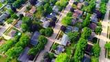 Beautiful, idyllic neighborhoods, homes, Summertime aerial view at sunrise.  - 213708314
