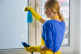 Woman cleaning window at home - 213711731