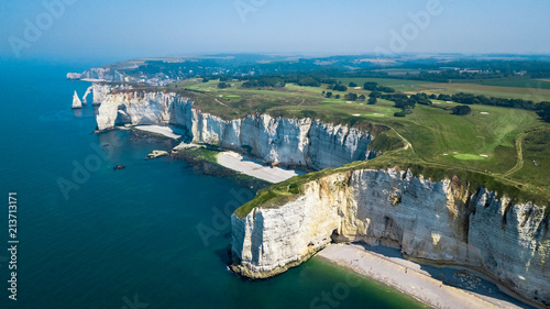 Drone view of seashore cliffs in Etretat France with a golf course - 213713171