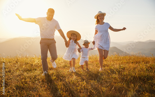 Happy family: mother, father, children son and daughter on sunset - 213719584