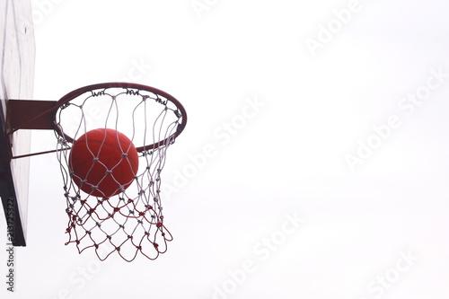 Fotobehang Basketbal Basketball on iron loop and net. Basketball on isolated background.