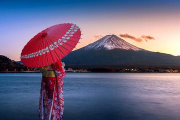 Asian woman wearing japanese traditional kimono at Fuji mountain. Sunset at Kawaguchiko lake in Japan. © tawatchai1990