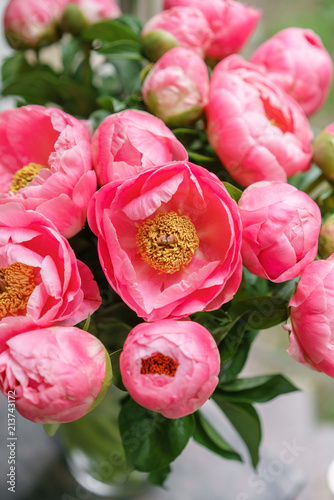 pink peonies. Beautiful summer bouquet. Floral composition. Wallpaper. Lovely flowers in glass vase. - 213743172