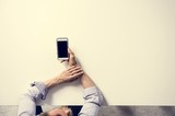 Man holding a smartphone on the table - 213747374