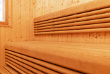 Interior of Finnish sauna. Classic wooden sauna. Finnish bathroom. Wooden sauna cabin. Wooden room. Sauna steam.. - 213748197