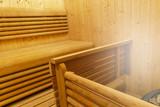 Interior of Finnish sauna. Classic wooden sauna. Finnish bathroom. Wooden sauna cabin. Wooden room. Sauna steam.. - 213748199