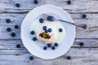 A delicious dessert with steamed dumpling and freshly picked fruits on a wooden table.