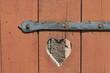 heart in a wooden door as symbol