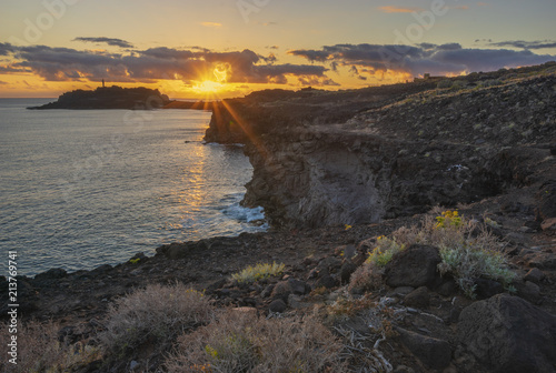 Rocky coastline with lighthouse on the sunset. Punte del Teno,tenerife - 213769741