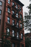 Facade of a typical New York block of flats with fire escape at the front.