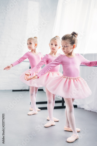 Foto Murales adorable little ballerinas practicing together in ballet studio