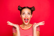 Leinwandbild Motiv So excited and positive girl isolated on red background loud laughs raising her head and hands up. Concept of advertising, sale and discount isolated on red background