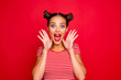 Leinwanddruck Bild - WOW! Portrait of astonished surprised girl with wide open mouth eyes gesturing with palms near face isolated on red background