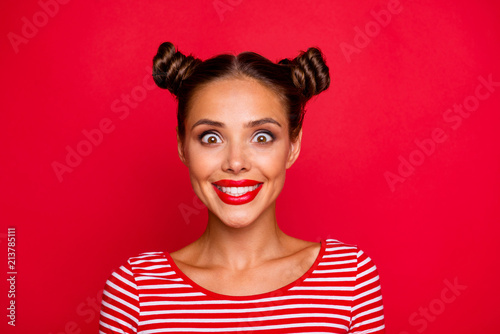 Leinwandbild Motiv Closeup of happy face young girl with red lips and big brown eyes look at camera on red background